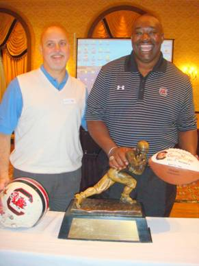 My favorite pic of me and George.  Thats the game ball from beating Michigan in 1980 and the Heisman Trophy.